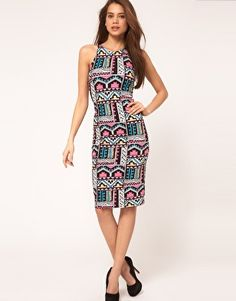 Bodycon midi dress by Motel. Crafted in cotton rich jersey with a soft stretch handle and Aztec print design. Featuring a round neckline, sleeveless styling with cut-away shoulders and a racer back design to reverse. Designed with a bodycon fit and a midi cut length.