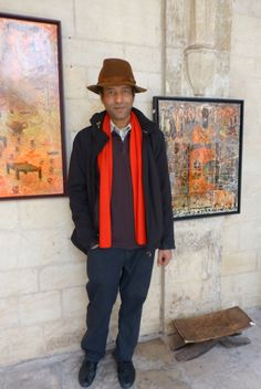 Islam Zian-Alabdeen with two of his paintings http://entreetoblackparis.blogspot.fr/2013/03/africa-unlimited-at-cloitre-des.html
