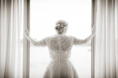 Bride at the window Photos by mckenzie brown photography