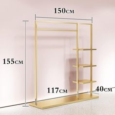 Golden Metal Clothes Rack Display Fixture Organizer Source by clothing rack Wall Mounted Clothing Rack, Wood Clothing Rack, Wooden Clothes Rack, Pipe Clothes Rack, Kids Clothing Rack, Clothing Store Design, Clothes Stand, Clothing Stores, Clothing Store Displays