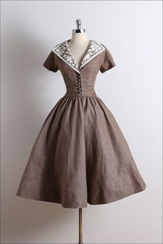 ➳ vintage 1950s dress * heavy tan cotton linen * button bodice accents * white bead & sequin accents * floral accents * metal side zipper condition | excellent fits like small length 49 bodice 19 bust 38 waist 27 some clothes may be clipped on dress form to show best fit for appropriate size. ➳ shop http://www.etsy.com/shop/millstreetvintage?ref=si_shop ➳ shop policies http://www.etsy.com/shop/millstreetvintage/policy twitter | MillStVintage facebook | millstreetvintage instagram | mi...