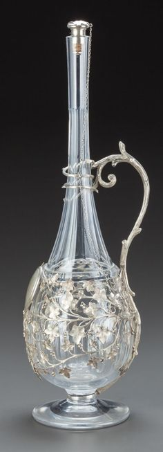 A BACCARAT GLASS AND SILVERED METAL MOUNTED CLARET JUG