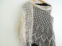 This is hand knitted - its really so gorgeous! Imagine hours upon hours of this detailed work. I love this shawl.