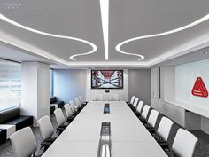 Avery Dennison HQ Office. Channels in the boardroom's stretched ceiling allow LEDs to shine through. #office large company
