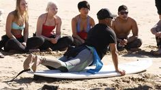 Surfing instructer teaching how to get up on the board. Surf camp in Morocco.  #KILROY #Africa