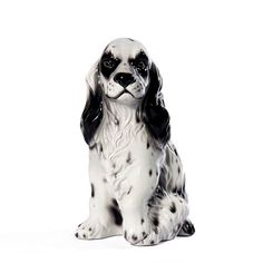 """Sitting Cocker Spaniel statue 11.5 inches high.  Beautiful ceramic sculpture hand made in Italy by skilled artisans.  Rich in detail and colors.  Patterns and colors may vary slightly.  Ships FREE in continental USA Dimensions:  11.5""""H Material:  Fine Italian Ceramic Shipping Dimensions: 12""""L 12""""W 16""""H Item # 11039 Price: $89.99"""