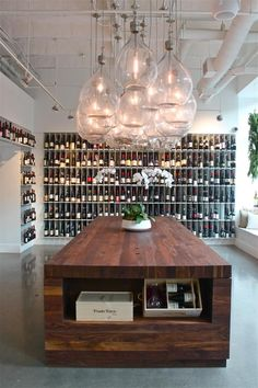 Urban Grape South End - tasting table and demijohn chandelier