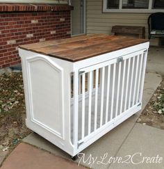 Baby crib converted into a super stylish dog crate one wheels.