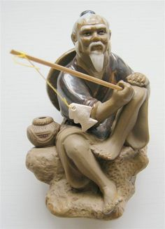 Asian metal figurine fisherman