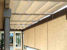 Use Slide Wire Canopy outdoors. That way Winter time it can be opened to allow Full Sunlight, to beat home. Conversely, during summer it is closed to provide full shading.   Also use Line-X on wooden pergola frame. Will last almost a lifetime, even through extreme weather!
