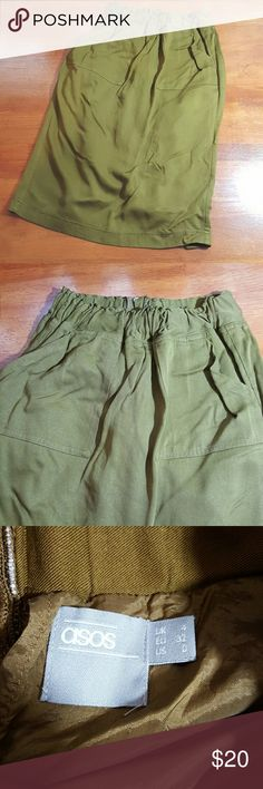 Asos skirt Army green color...super elastic waist...has front pockets...split in back..very cute but in spots the slips hangs lower than skirt...i was thinking about tacking down with fabric tape to kep slip from hanging too low...or i can leave it alone...make an offer ASOS Skirts