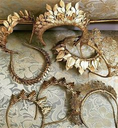 A gilded fabric laurel crown,  headbands.