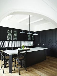 Greg Natale - kitchens - black and white kitchens, black cabinetry, black cabinets, black kitchen island, black island, hardwood floors, rus...