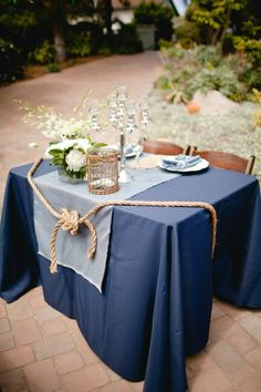 love the idea of a knot being at the sweetheart table...maybe this with an ampersand, tying the two chairs together?