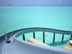 This Insane Waterslide Lands You in a Gorgeous Turquoise Ocean | CoastalLiving. Maldives.