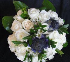 white and blue Scottish thistles