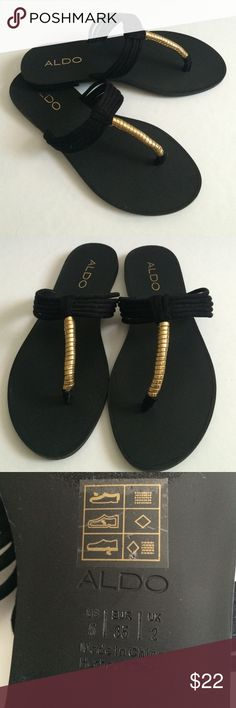 Aldo Sandals - Black with Gold Accent Cute flip flops that can be dressed up or down. Brand new - only wore inside to try on, but they are a little too loose on my feet. Aldo Shoes Sandals