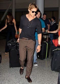 for air travel. loafers. loose shirt. sun glasses.