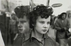 Photo by Saul Leiter, Untitled (girl with reflection).