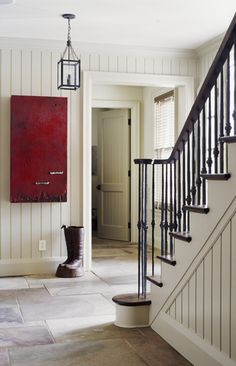 Clean and quiet with just a touch of moody red #stairs #paneling #decor