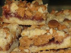 Penut Butter and Jelly Bars ~ These are favorites with the grand kids and adults alike. I wish I can remember where I got the recipe. It seems it was on an Internet food forum.I also make them substituing lemon curd for the jelly and white chocolate chips for the peanut butter chips. Lemon Lusciousness!