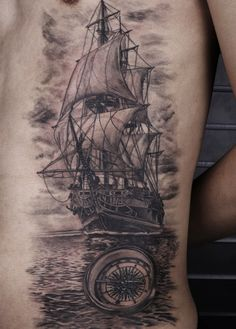 ship,compass black and gey tattoo