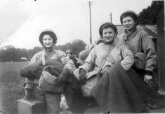 "Three nurses of the 203d Gen. Hosp. prepare for movements overseas. Note that all three wear the Winter Combat Jacket (""Tanker"" jacket). This photograph was taken in England prior to the unit's embarkation to Normandy, 1944 ~"