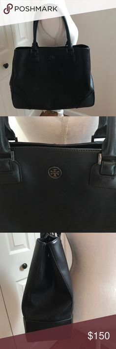 Tory Burch leather tote Black leather Tory Burch tote. Shoulder bag with multiple compartments and zippers inside. Great condition. Minimal wear on the outside. Some staining on the fabric inside. Comes with dust cover Tory Burch Bags Shoulder Bags