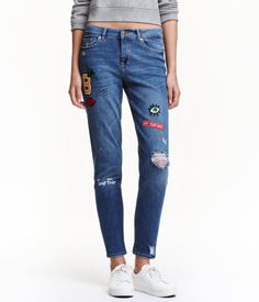 Denim blue. 5-pocket jeans in washed denim with heavily distressed details. Regular waist, zip fly, and slightly wider, tapered legs. Printed motifs and