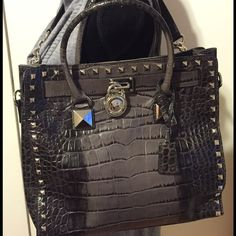 Rare Michael Kors Hamilton satchel LT Gray/Dk Gray Rare Michael Kors Handbag in perfect condition only carried a few times. This bag is simply gorgeous will complement any outfit!!  Has silver hardware dimensions are 13 x 14 x 5 comes with duster Michael Kors Bags Satchels