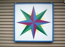 This block was the first barn quilt block to be displayed in Maine. The barn quilt block is hung at the North Woods Quilting, which is home and quilt shop owned by the Flanders in Wilson's Mills, Maine.