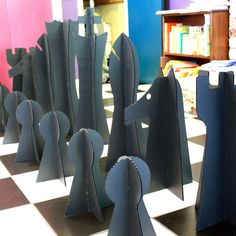 Giant Chess set Made with cardboard or plastic, he had these cut by laser, and they store FLAT! :D