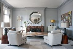 About this marveloous modern living room, Jean-Louis Deniot takes advantage of the empty space above the fireplace in this Parisian residence with a silver octagonal design. 10 Must-See Wall Mirror Ideas to Inspire You Today ➤ Discover the season's newest designs and inspirations. Visit us at http://www.wallmirrors.eu #wallmirrors #wallmirrorideas #uniquemirrors @WallMirrorsBlog