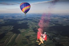 nice Skydivers Play on an Enormous Swing Suspended Between Two Hot Air Balloons