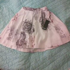 NWT Floral Skirt Beautiful and brand new!  Watercolor floral print Forever 21 Skirts
