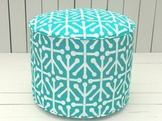 A trellis printed fabric covers this vibrant drum-shaped pouf. Get it in custom colors and patterns that will really make it yours. Turquoise Outdoor Pouf;  etsy.com/shop/anitascasa