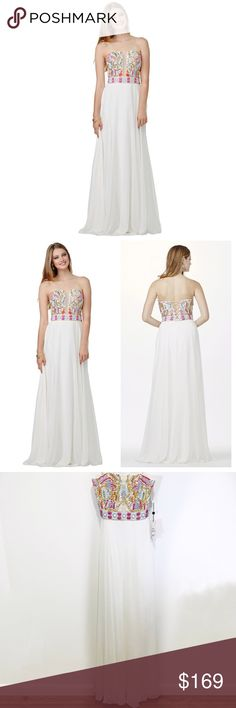 """new   JVN Jovani Beaded Bodice Prom Gown + Shawl 6 This white chiffon gown by Jovani showcases a straight strapless bodice with semi-open back, stunningly embellished with multi-colored beads. Sheer inset runs from the neckline to the beaded waistband. The long skirt flows creating a soft A-line silhouette. Bodice boned & padded.   Matching sheer shawl that features beads along edges. Shawl has a tiny spot towards the middle but not noticeable. Style JVN31751  • size 6 • 34"""" bust (can be…"""