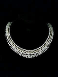 #DiosabyDarshanDave #necklaces are exquisitely articulated with invisible #SterlingSilver wires, which showcase each stone to achieve its maximum scintillation. Featuring a #classic design, this #necklace presents yellow and white fancy cut #SwarovskiZirconia intricately hand-set by expert craftsmen. Ideal for #bridalwear and #destinationweddings! Available at #JewelleryArabiaShow, Bahrain from 24th to 28th November at #boothC14 in Palm Hall Diamond Bar Necklace, Diamond Jewellery, Diamond Gemstone, India Jewelry, Fine Jewelry, Boucheron Jewelry, Fashion Rings, Women's Fashion, Diamond Dreams
