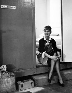 Audrey Hepburn on the set of The Children's Hour with her yorkshire terrier Famous. Photograph by Bob Willoughby, 1961.