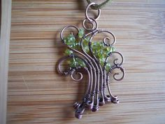 Wire Peridot Tree Pendant Green Peridot Chip beads Wire Wrapped in Oxidized Copper wire.  via Etsy.