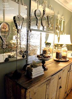 Hand mirrors layered over wall mirrors- I love this idea!