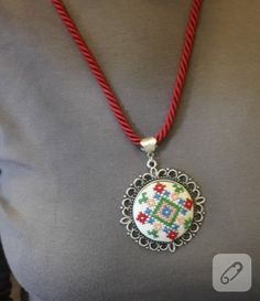 Ethamine embroidered cross-stitch necklace with red cord detail is very elegant . Tiny Cross Stitch, Cross Stitch Needles, Cross Stitch Designs, Cross Stitch Patterns, Wool Embroidery, Hand Embroidery Designs, Cross Stitch Embroidery, Mini Mandala, Cross Stitch Collection