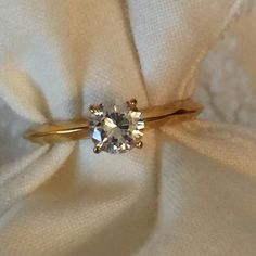Solitaire Cubic Zirconia Ring Gold-tone ring with stone set in four prongs. NWOT. Jewelry Rings