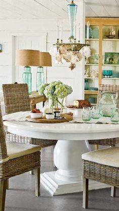breakfast room with woven chairs and white lacquered table