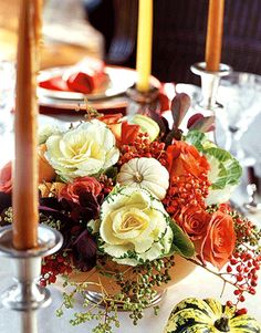Make the centerpiece as colorful as the rest of the table. Keep it compact so it doesn't interfere with the passing of dishes.