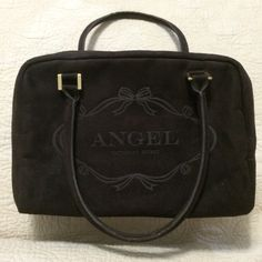"""Victoria's Secret Angel Chocolate Sueded Satchel Soft sueded chocolate brown exterior, chocolate brown interior, gold toned hardware. No interior or exterior pockets. There are a few marks here and there from very minimal wear. There is a hard piece at the bottom that gives the bag some structure. The bottom is approximately 11.5"""" x 5"""" and it's 8"""" deep with an 8"""" handle drop. Victoria's Secret Bags Satchels"""