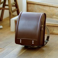 """Every Japanese primary school kids' first school backpack is one of these - a ランドセル (""""randoseru""""). Handmade out of leather, they last forever and are very expensive. This one costs ~$600. Traditionally it's the grandparents who pay for it."""