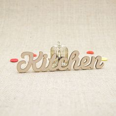 MDF wooden kitchen word shape laser cut from Premium 3mm MDF (Medium Density Fibreboard). Sizes from 3cm to 6cm tall in 3mm thickness.