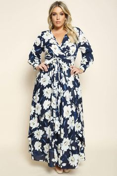 A plus size maxi dress with a wrapped V-neckline and long sleeves. Features a belted waistline. Floral print all over.