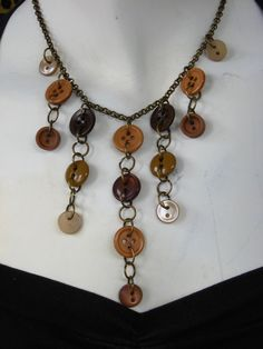 In case you couldn't tell, I'm going down a 'button jewelry' tag page...but how pretty is this??